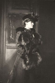 Edith Wharton in a hat with a feather, coat with fur trim, and fur muff. Newport, Rhode Island, USA, 1907.    Source: Beinecke Rare Book & Manuscript Library, Yale University