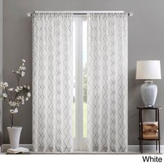 Filter the glare for softer light by placing this sheer Madison Park curtain panel in a striking diamond pattern at your window. Unlined to maximize the amount of light passing through, this panel's d