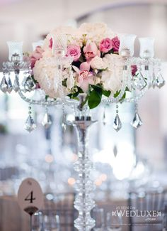 Crystal candelabras with pink flowers. Creations by Gitta.