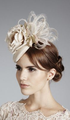 Gina Foster Millinery, Bridal 2014 - Silk grosgrain button trimmed with a feather spray and silk rose. Secured with an elastic that sits under the hair.