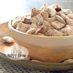 Salted Caramel Puppy Chow made with salted caramel, milk chocolate, chex cereal, and lots of powdered sugar. All-time favorite dessert! Everyone loves this.