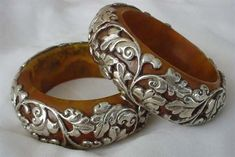 Tibet | Pair of Vintage Honey Amber and Sterling silver Repousse bangles. #SilverJewelry