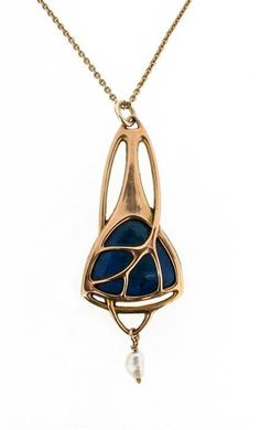A Jugendstil gold pendant (Germany Circa 1900). Mounted with 'Swiss lapis' with freshwater pearl.