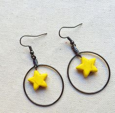 Yellow star earrings by CraftingAwayTheFeels on Etsy