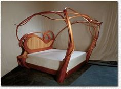 Art Nouveau bed in mahogany and oak. So organic, has a Knoxian feel about it. It would be like sleeping under a tree