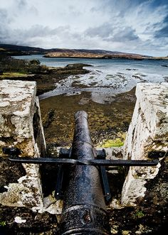 A canon gaurds Castle Dunvegan on the Isle of Skye, Scotland