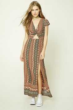A woven maxi dress featuring an allover abstract print, a twisted V-neckline, cap sleeves, a waist cutout, M-slit skirt, and a concealed back zipper.