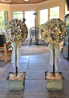 http://craftywedding.wordpress.com/2013/09/22/origami-paper-flower-topiary-the-wthwit-project/