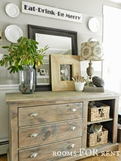 grey washed buffet.  like the striped wall for accent in my DR and the way the top stripe is the paint color used in all adjoining rooms