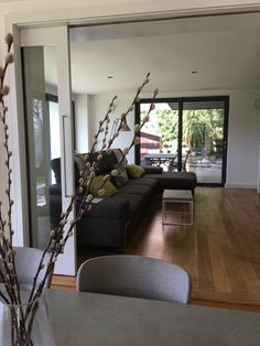 The big sliding doors were a great idea. We can make the family room cosy, or have one large space.