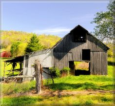 Spring On the Farm ... it makes you wonder how many years this barn must have stood here to have become so weathered and worn