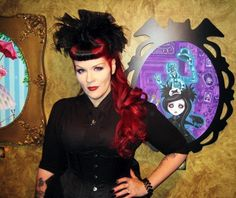 Goth artist Queenie with one of her Haunted Mansion tributes (www.pocketfullofposiez.com).