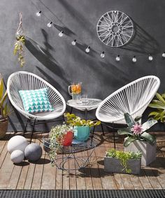 Outdoor setting with faux Acapulco chairs.