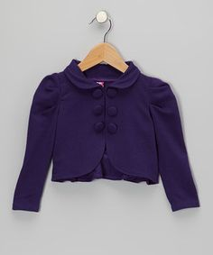 Gathering at the shoulders, a ruffled hem and two rows of faux buttons lend this cozy jacket personality and flair to spare. Connected by a button-loop closure at the collar, its open design is trendy and excellent for layering.
