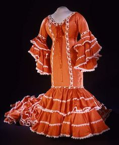 This bata cubana costume was worn by Celia Cruz at the Apollo Theater in Harlem, New York, in 1985. Cuban roots, salsa, African rhythms, and more combine in her music, which she constantly re-invented--much like her colorful wardrobe. #mashup