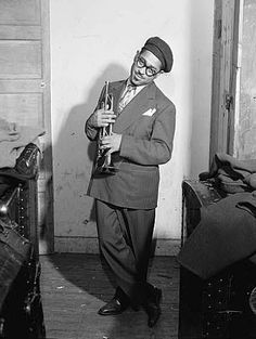 Listen to music from Dizzy Gillespie like On The Sunny Side Of The Street, Bang Bang & more. Find the latest tracks, albums, and images from Dizzy Gillespie. Jazz Artists, Jazz Musicians, Trombone, Eugene Smith, Trip The Light Fantastic, Dizzy Gillespie, Afro Cuban, Cool Jazz, Beatnik