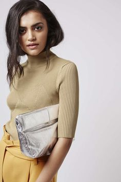 Slouchy, cuddle-me-close shapes make the clutch a statement for the new season. This foil leather textured style features a roll-over top with a mag-dot fastening to close. #Topshop