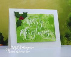 Splash Water Coloring by Loll Thompson - Merry Christmas with Holly card design.  White embossed greeting done first, then the splash.