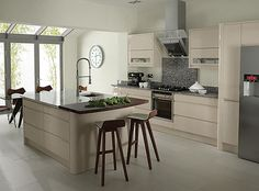 Remo Beige kitchen, mini breakfast bar with a different counter top like a butchers block.