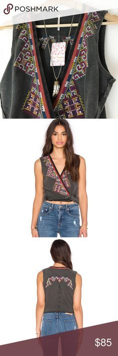 Free People Around The World Embroidered Tank Wrap around style. Gorgeous embroidered detail. Black combo. New with tags. Free People Tops