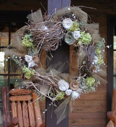 Wreaths decorated with burlap flowers--found the idea on Pinterest and made it our own!