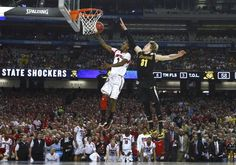 Louisville Cardinals guard Russ Smith (L) drives to the hoop past Wichita State Shockers guard Ron Baker during the second half of their NCAA mens Final Four basketball game in Atlanta, Georgia April 6, 2013. (Chris Keane/Reuters)