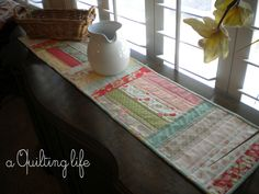 A Quilting Life: Simple Table Runner--A Tutorial  http://www.aquiltinglife.com/2012/08/simple-table-runner-tutorial.html