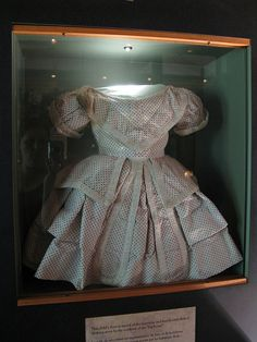 Oakley Plantation's Museum  State Highway 965, St. Francisville, West Feliciana Parish, Louisiana  Exhibit Description: This child's dress is typical of the luxurious and heavily embellished clothing worn by children of the Plantation owners.