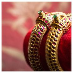 Ornate bangles beautifully studded with Yakhoot (ruby) and adorned with pearl with pearls depicting a classic tale of Hyderabadi heritage. Nizam Jewellery, Antique Jewellery, Temple Jewellery, Bridal Jewellery, Gold Bangles Design, Jewelry Design, Gold Bangle Bracelet, Diamond Bracelets, Silver Bracelets