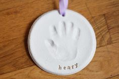 "DIY salt dough handprint ornament. 1 cup flour, 1/2 cup salt and 1/2 cup water. Knead until smooth, roll out to 1/4"". Bake at 200° for a few hours. Paint white and/or spray with clear gloss"
