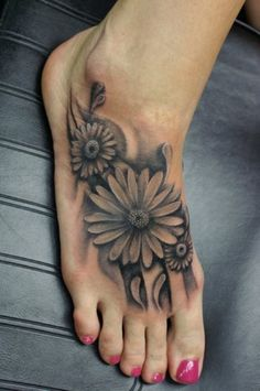 black and white flower foot tattoo