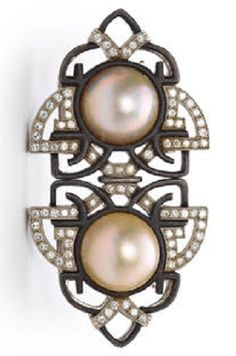 An Art Deco mabé pearl, diamond and blackened steel double-clip brooch, Marsh & Co, circa 1935. Each centring a circular mabé pearl within a scrolling motif of blackened steel and accentuated with round brilliant-cut diamonds, delicately etched to reverse; unsigned; mounted in platinum. #Marsh #ArtDeco #brooch