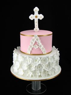 Chocolate mudcakes with milk chocolate ganache and covered in fondant. All the flowers and cross are handmade from fondant.