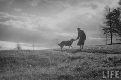 A Shaker woman with her dog, from the LIFE Magazine Archives.