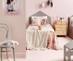 This shared girls' bedroom with painted 'house' headboards combines dusky pink and elephant grey to gorgeous effect. See how to get the look