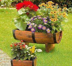 #Reutilizar um #barril para #decorar o #jardim. Saiba como fazer mais coisas em http://www.comofazer.org