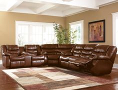 Ashley Furniture Revolution Reclining Sectional in Saddle