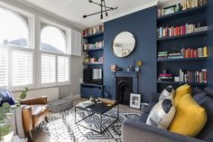 Dramatic and contemporary dark blue interior design - the transformation of my Victorian living room. Stiffkey Blue walls by Farrow & Ball, contrasted with Ammonite grey walls. Dark walls in a living room don't need to mean a dark space, here the mix of t Family Living Room Design, Blue Interior Design, Blue Living Room, Family Living Rooms, Living Room Modern, Living Room Grey, Room Decor, Victorian Living Room, Blue Interior