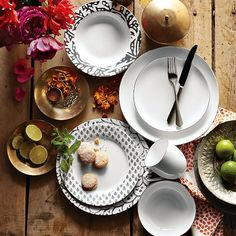 Understated elegance with a touch of glamour. The subtle asymmetrical shape of west elm's best-selling Organic Shaped Dinnerware gets rimmed in metallic silver and gold, perfect for casual dinners as well as more formal affairs.