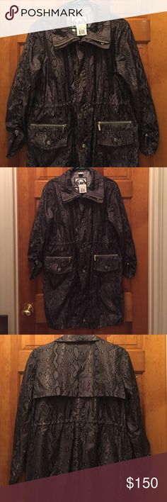 """HP 🎉🎉Michael Kors snakeskin pattern trench coat. This is such a beautiful jacket/windbreaker! Perfect for back to campus look and for those cool fall nights. It is a gem! It is a snakeskin taupe color with zipper and button front. Drawstring pulls on the bottom of the sleeves, the waist, and the bottom of the jacket. Front snap button and zippered pockets. Back has a top flap for decoration. 100%polyester. It is a really gorgeous jacket in P/M. 36 inch length. I'm 5'2"""" and it goes past my…"""