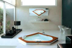 The Aura Whirlpool Bath from Jacuzzi gives that 'home spa' look. Very nice.