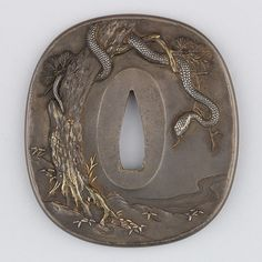 tsuba* snake on a tree