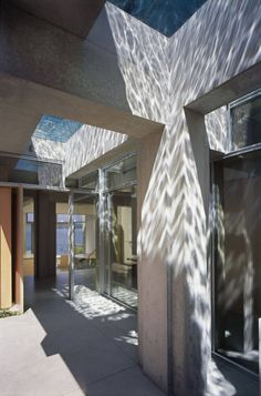 12 Concrete Interiors: See the chevron pattern of light on the concrete pillars in the entryway of this Vancouver home designed by Petkau Architects? They're cast by water from the glass-bottomed swimming pool above. Seriously cool.