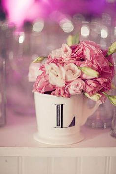 "Love it! Get all 4 mugs from Anthropologie to spell out ""LOVE"" and put flowers in each! Great for the head table!"