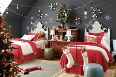 Decorate your kids' bedroom for the holidays with red bedding and chalkboard snowflakes!