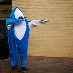 This #txst student has been cheering campus up during finals. Why does he do it? 'Cause every girl's crazy 'bout a shark dressed man! by txst