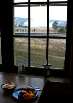 Dining in Yellowstone National Park. Old Faithful erupts in the background!