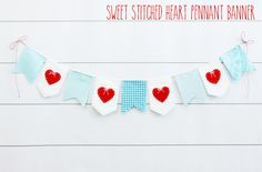 Stitched Heart Banner - A cute and easy Valentine's decor project! It hardly takes any time to put together but it's so cute and adds a fun touch of color for Valentine's Day!