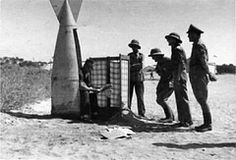 "Four DAK* soldiers queuing up to use a most originally designed latrine - World War II * = DAK, or ""Deutsches Afrika Korps"""