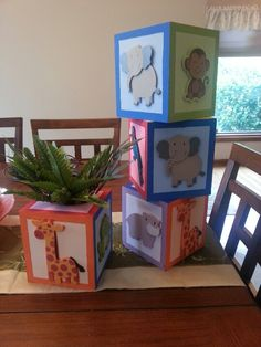 Made from wooden tissue box covers. Centerpiece for Baby Shower with jungle themed greenery coming out the top.